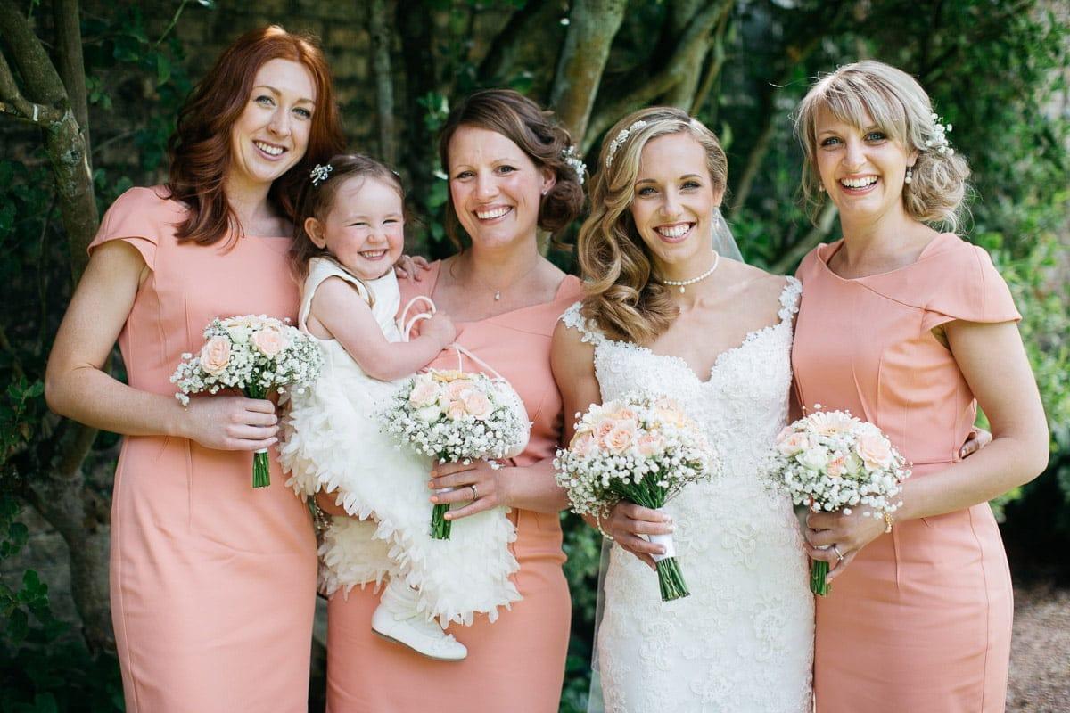bridesmaids wearing pastel colours, white dress, wedding dress, flower girl, flowers, wedding photography