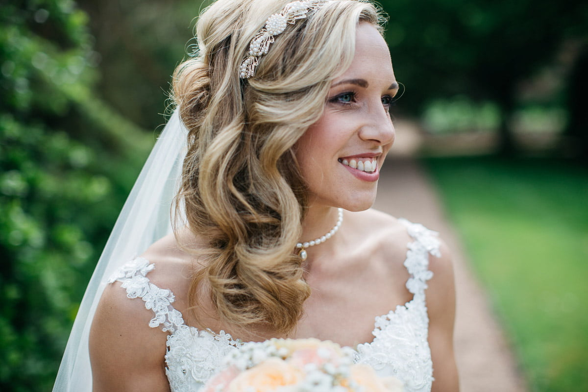 bride smiling in the gardens at saltmarsh hall