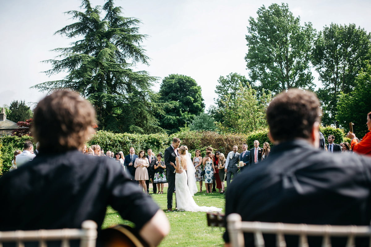 Outdoor first dance with wedding band in the gardens at Saltmarsh hall